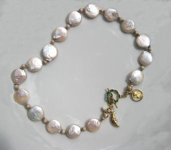 #N034 Flat white pearls emerald clasp